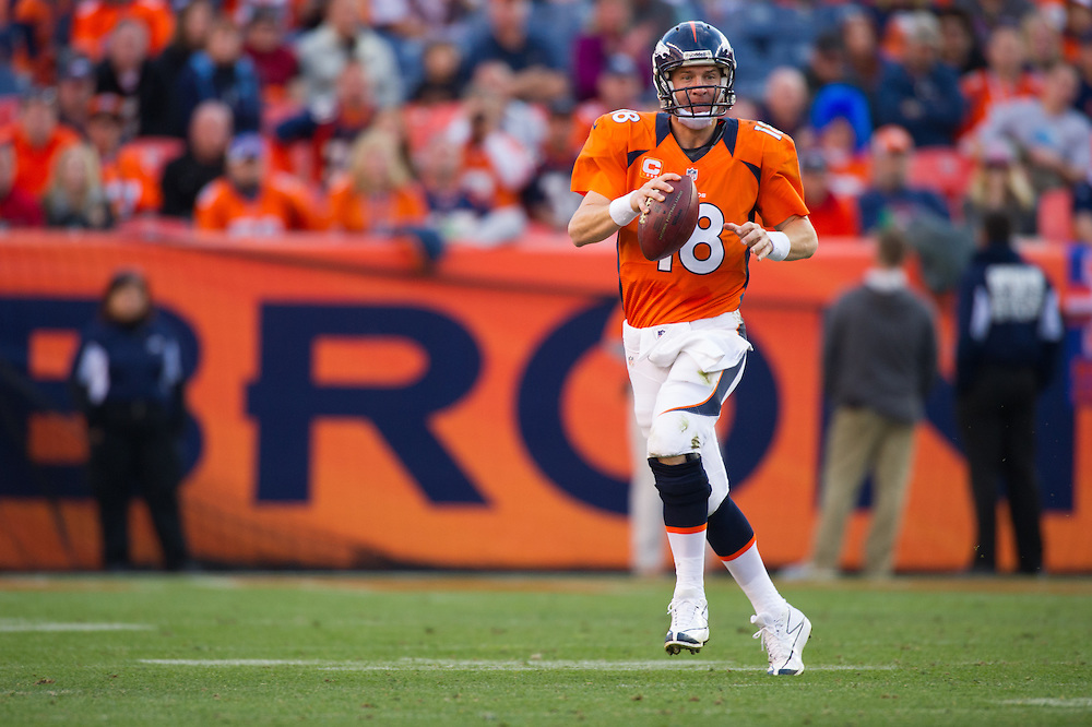DENVER, CO - DECEMBER 2:  Quarterback Peyton Manning #18 of the Denver Broncos drops back to pass during a game against the Tampa Bay Buccaneers at Sports Authority Field Field at Mile High on December 2, 2012 in Denver, Colorado. (Photo by Rob Tringali) *** Local Caption *** Peyton Manning