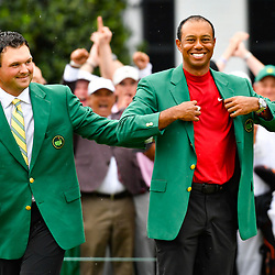 Apr 14, 2019; Augusta, GA, USA; 2018 winner Patrick Reed places the green jacket on 2019 winner Tiger Woods after the final round of The Masters golf tournament at Augusta National Golf Club. Photo : Michael Madrid / SUSA / Icon Sport