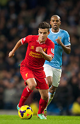 MANCHESTER, ENGLAND - Boxing Day Thursday, December 26, 2013: Liverpool's Philippe Coutinho Correia in action against Manchester City during the Premiership match at the City of Manchester Stadium. (Pic by David Rawcliffe/Propaganda)