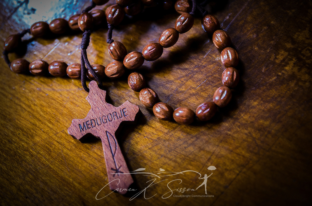 A rosary lies on a church pew at Chapel of Mercy in Greenwood, Miss. (Photo by Carmen K. Sisson)