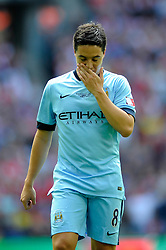 Manchester City's Samir Nasri cuts a dejected figure after Manchester City lose in the FA Community Shield to his former team, Arsenal - Photo mandatory by-line: Dougie Allward/JMP - Mobile: 07966 386802 10/08/2014 - SPORT - FOOTBALL - London - Wembley Stadium - Arsenal v Manchester City - FA Community Shield