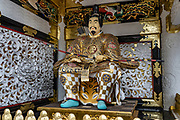 "Toshogu Shrine is the final resting place of Tokugawa Ieyasu, the founder of the Tokugawa Shogunate that ruled Japan for over 250 years until 1868. Ieyasu is enshrined at Toshogu as the deity Tosho Daigongen, ""Great Deity of the East Shining Light"". Initially a relatively simple mausoleum, Toshogu was enlarged into the spectacular complex seen today by Ieyasu's grandson Iemitsu during the first half of the 1600s. The lavishly decorated shrine complex consists of more than a dozen buildings set in a beautiful forest. Countless wood carvings and large amounts of gold leaf were used to decorate the buildings in a way not seen elsewhere in Japan. Toshogu contains both Shinto and Buddhist elements, as was common until the Meiji Period when Shinto was deliberately separated from Buddhism. Toshogu is part of Shrines and Temples of Nikko UNESCO World Heritage site."