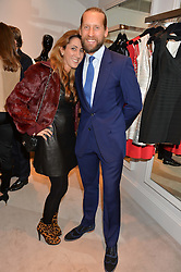 JAKE & SAMIRA PARKINSON-SMITH at a party at Herve Leger, Lowndes Street, London on 12th November 2014 to view the latest collection.