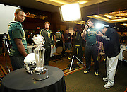 12//29/09  - The Oregon Ducks Ed Dickson (83) stands near the Rose Bowl trophy with teammates nearby which was on display during team media day Wednesday morning at the downtown L.A. Marriott.
