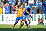 Alfredo Morelos (#20) of Rangers FC shields the ball from Joe Shaughnessy (#5) of St Johnstone FC during the Ladbrokes Scottish Premiership match between St Johnstone FC and Rangers FC at McDiarmid Park, Perth, Scotland on 23 December 2018.