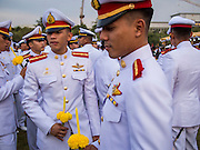 Thai military cadets at the celebration of the birthday of the King. Thais observed the 86th birthday of Bhumibol Adulyadej, the King of Thailand, their revered King on Thursday. They held candlelight services throughout the country. The political protests that have gripped Bangkok were on hold for the day, although protestors did hold their own observances of the holiday. Thousands of people attended the government celebration of the day on Sanam Luang, the large public space next to the Grand Palace in Bangkok.