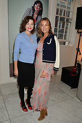 Left to right, JASMINE GUINNESS and YASMIN LE BON at the launch of the 'Jasmine for Jaeger' fashion collection by Jasmine Guinness for fashion label Jaeger held at Fenwick's, Bond Street, London on 9th September 2015.