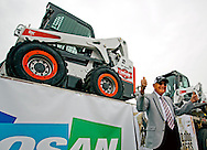 Cy Keller, one of the inventors of the original three-wheeled loader, approves of the one-millionth Bobcat skid-steer loader which rolled off the production line in Gwinner, N.D., on Saturday, July 12, 2014. Keller and his late brother, Louis, built the first loader in Minnesota in 1957 before partnering with Melroe Manufacturing a year later. The ceremony was held at the Gwinner production facility where 1,230 people are employed.<br /> Nick Wagner / The Forum