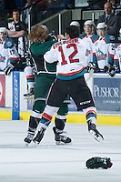 KELOWNA, CANADA - DECEMBER 30:  Tyrell Goulbourne #12 of the Kelowna Rockets drops the gloves with Lucas Grayson #20 of the Everett Silvertips at the Kelowna Rockets on December 30, 2012 at Prospera Place in Kelowna, British Columbia, Canada (Photo by Marissa Baecker/Shoot the Breeze) *** Local Caption ***