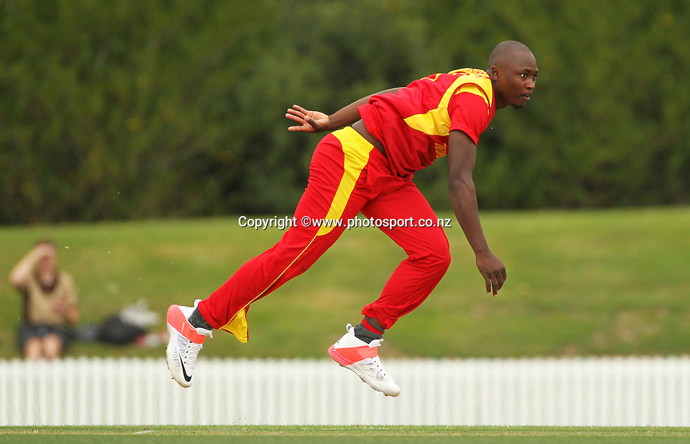 Tendai Chatara of Zimbabwe bowling during the ICC Cricket World Cup warm up game between the Black Caps v Zimbabwe at Bert Sutcjliffe Oval, Lincoln, Christchurch. 9 February 2015 Photo: Joseph Johnson / www.photosport.co.nz