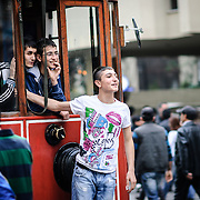 Young Turks riding the tram in the Beyoglu district of Istanbul, Turkey.