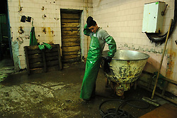Seasonal fish workers take a break after processing a small amount of salmon brought in late in the evening at the factory Okean -Zapad in Ust Bosheresk, Kamchatka August 16, 2007.