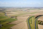 Nederland, Zuid-Holland, Hoeksche Waard, 04-03-2008; autosnelweg A 29 tussen Klaaswaal en Oud-Beijerland doorsnijdt de leegte van de Hoeksche Waard; de weg buigt af naar het noordoosten (richting Heinenoord /Barendrecht); het ligt in de bedoeling dat in de toekomst op dit punt de A4 zal aansluiten, komen vanaf het Noorden; aan de horizon de Rotterdamse haven met Europoort en Pernis. .luchtfoto (toeslag); aerial photo (additional fee required); .foto Siebe Swart / photo Siebe Swart