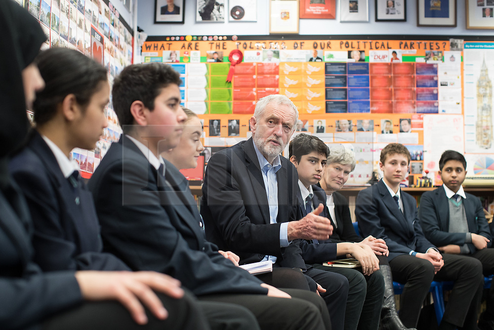 © Licensed to London News Pictures . 22/03/2018. Manchester, UK. JEREMY CORBYN visits a class at Stretford High School with local MP KATE GREEN (3rd from right) , in Trafford , after launching of the Labour Party's local election campaign . Photo credit: Joel Goodman/LNP