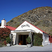 The Gibbston Valley vineyard in Gibbston Valley, Central Otago. The winery includes a cave which has been blasted out of the solid schist of the Central Otago mountains, and creates an ideal natural environment to mature award-winning wines, Gibbston Valley Wines,  Queenstown, Central Otago, New Zealand. 23rd March  2011. Photo Tim Clayton.