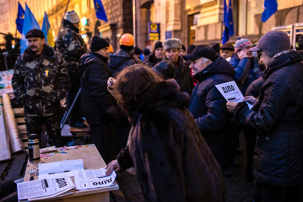 KIEV, UKRAINE - DECEMBER 13: A free newspaper, the Daily Maidan, is distributed to anti-government protesters near Independence Square on December 13, 2013 in Kiev, Ukraine. Thousands of people have been protesting against the government since a decision by Ukrainian president Viktor Yanukovych to suspend a trade and partnership agreement with the European Union in favor of incentives from Russia. (Photo by Brendan Hoffman/Getty Images) *** Local Caption ***