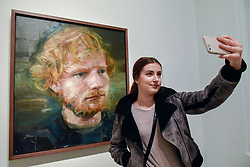 © Licensed to London News Pictures. 03/05/2017. London, UK.  Inez Brogowska, an Ed Sheeran fan from Poland, visits the National Portrait Gallery to take a selfie with a newly acquired portrait of the popular singer-songwriter Ed Sheeran, by artist Colin Davidson.  The 4ft x 4ft painting oil painting is the first portrait painted of the singer since the start of his professional career and has just been put on public display.   Photo credit : Stephen Chung/LNP