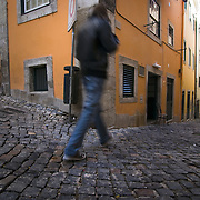 A young man in the old streets of the Alfama in Lisbon