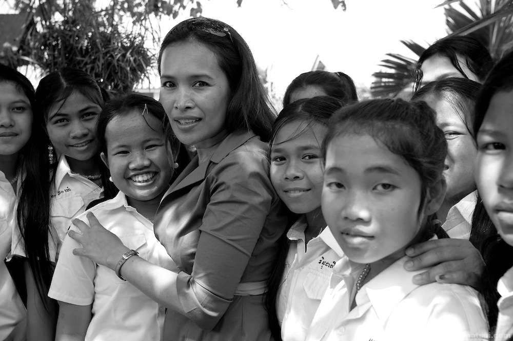 "AFESIP President Somaly Mam with girls rescued from sex trafficking at Tom Dy, a residential facility of the non governmental organization ""Acting for Women in Distressing Situations"" (AFESIP), an ""A to Z"" Cambodian relief agency providing outreach, health services, retraining and residential housing in Phnom Penh, Cambodia. AFESIP clients are victims of sex trafficking, ex-prostitutes, or domestically abused. Founded by Somaly Mam, who herself was once a prostitute and victim of trafficking and domestic abuse, AFESIP has three facilities in Cambodia and works with other NGO's to provide long term care for the women. An english translation of her autobiography will be released in September 2007."