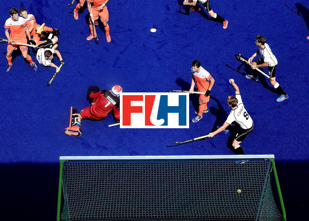 Germany's Martin Haner (2nd L) dives to score a goal during the men's Bronze medal field hockey Netherlands vs Germany match of the Rio 2016 Olympics Games at the Olympic Hockey Centre in Rio de Janeiro on August 18, 2016. / AFP / MANAN VATSYAYANA        (Photo credit should read MANAN VATSYAYANA/AFP/Getty Images)