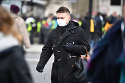 © Licensed to London News Pictures. 09/03/2020. London, UK. A member of the public on Westminster Bridge in central London, wearing a medical mask. New cases of the COVID-19 strain of Coronavirus are being reported daily as the government outlines it's plans for controlling the outbreak. Photo credit: Ben Cawthra/LNP