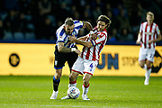 Steven Fletcher of Sheffield Wednesday and Joe Allen of Stoke City challenge for the ball during the EFL Sky Bet Championship match between Sheffield Wednesday and Stoke City at Hillsborough, Sheffield, England on 22 October 2019.