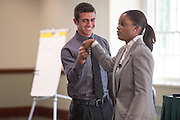 Brian Wallenhorst, left, a sophomore in the College of Business, and Brittany Tyree, right, the Senior Assistant Director of Career Management, show examples of poorly given handshakes during the How to Meet the Firms interactive student workshop on Sept. 6, 2016. Photo by Emily Matthews