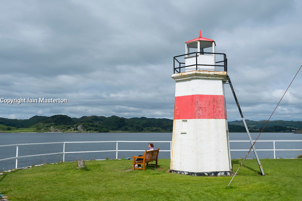 Small lighthouse at end of Crinan Canal at Crinan in Argyll and Bute, Scotland, United Kingdom