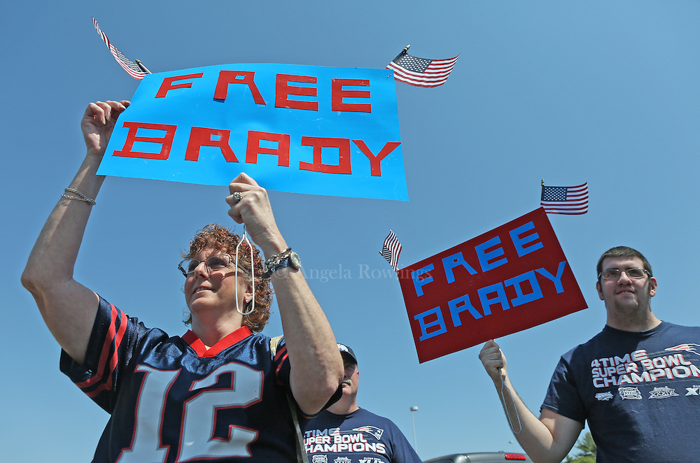 """(Foxboro, MA - 5/24/15) Doreen Domina of Enfield, Connecticut, and her son, Jacob Domina, join a couple hundred Patriots fans for a """"Free Tom Brady"""" rally at Gillette Stadium, Sunday, May 24, 2015. Staff photo by Angela Rowlings."""