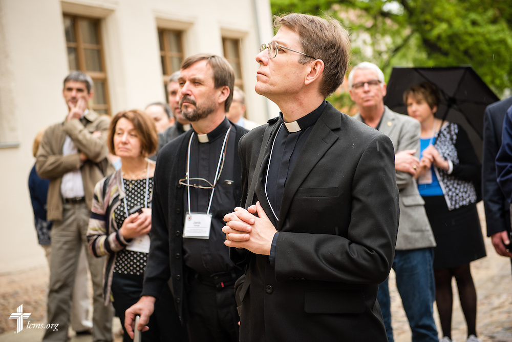 Church leaders listen as the Rev. Dr. Matthew C. Harrison (not pictured), president of The Lutheran Church–Missouri Synod, leads a tour of Wittenberg, Germany, on Tuesday, May 5, 2015. They are standing outside The International Lutheran Center at the Old Latin School. LCMS Communications/Erik M. Lunsford