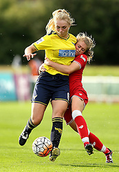 Millie Farrow of Bristol City Women hugs Rosie Lane of Oxford United as they battle for the ball - Mandatory by-line: Robbie Stephenson/JMP - 25/06/2016 - FOOTBALL - Stoke Gifford Stadium - Bristol, England - Bristol City Women v Oxford United Women - FA Women's Super League 2