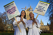 Angels walk tall for climate change, part of a CAFOD demonstration.