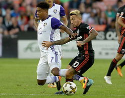 September 9, 2017 - Washington, DC, USA - 20170909 - Orlando City FC midfielder CRISTIAN HIGUITA (7) has his left leg get tangled in the legs of D.C. United midfielder LUCIANO ACOSTA (10) in the first half at RFK Stadium in Washington. (Credit Image: © Chuck Myers via ZUMA Wire)