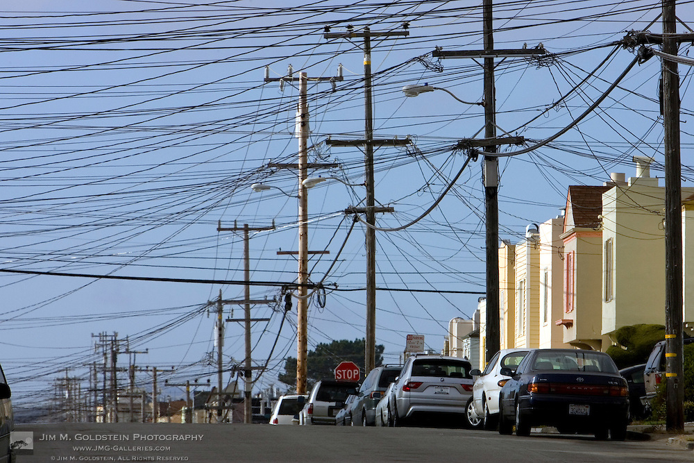 Profile of homes in the San Francisco Sunset District with power cords running to them.