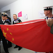Military personal prepare the flags for the medal ceremony of the Women's Synchronised 3m springboard diving competition at the Aquatic Centre at Olympic Park, Stratford during the London 2012 Olympic games. London, UK. 29th July 2012. Photo Tim Clayton