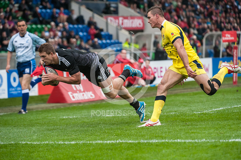 New Zealand's Scott Curry dives into the corner to score a try against Australia, during the quarter final game at the IRB Emirates Airline Glasgow 7s at Scotstoun in Glasgow. 4 May 2014. (c) Paul J Roberts / Sportpix.org.uk