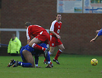 Photo: Jo Caird<br />Peterborough v Bristol City<br />Nationwide Div 2 2004<br />14/02/2004.<br /><br />Simon Rae and peter's Louis Carey get friendly