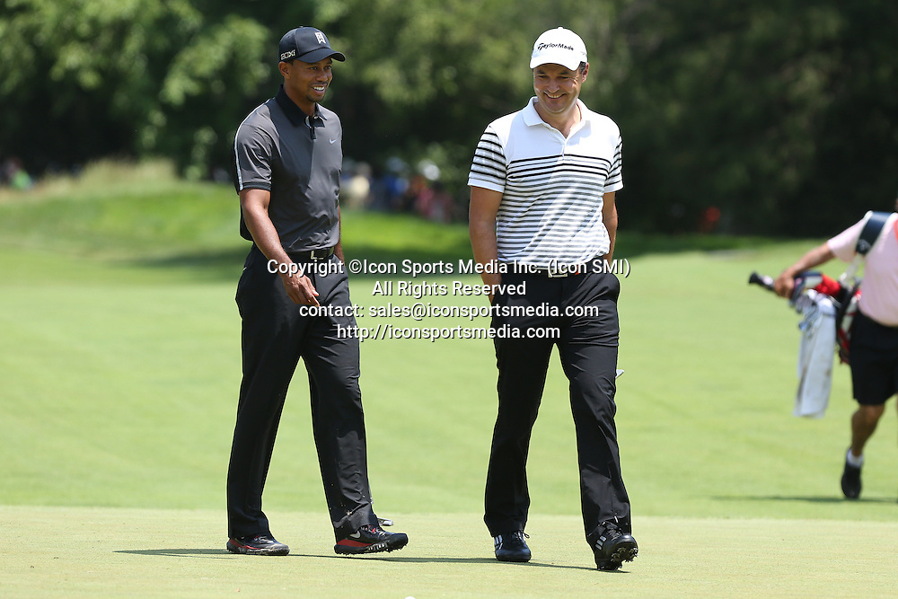 June 11 2013: Tiger Woods and Simon Khan share a lighter moment as the talk while walking to the 1st green during tuesday's practice round at the 2013 U.S. Open hosted by Merion Golf Club in Ardmore, PA.