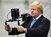 "© Licensed to London News Pictures. 04/04/2013. London, UK Boris Johnson films. Boris Johnson the Mayor of London, visits Ealing studios today, 4th April 2013, where he announced his plans to boost London's TV, Animation and Film industries, capitalising on the new tax relief brought in by the Chancellor (from 1st April 2013) to bring major jobs and investment to the capital. He toured the Studios and spent time in the ""Imaginarium"", where he had a go at mastering 'performance capture'. . Photo credit : Stephen Simpson/LNP"