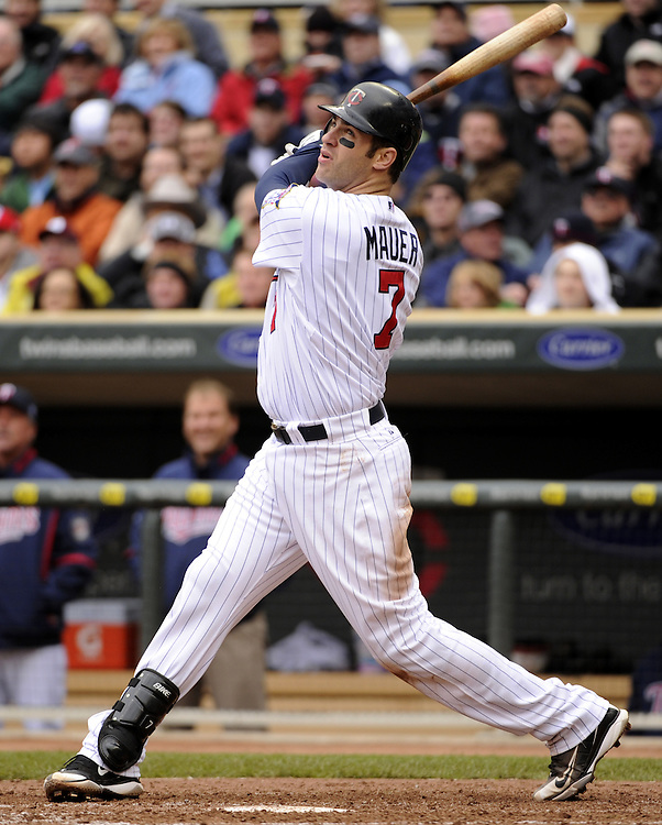 MINNEAPOLIS - MAY 12:  Joe Mauer #7 of the Minnesota Twins bats against the Chicago White Sox on May 12, 2010 at Target Field in Minneapolis, Minnesota.  The Twins defeated the White Sox 3-2.  (Photo by Ron Vesely)