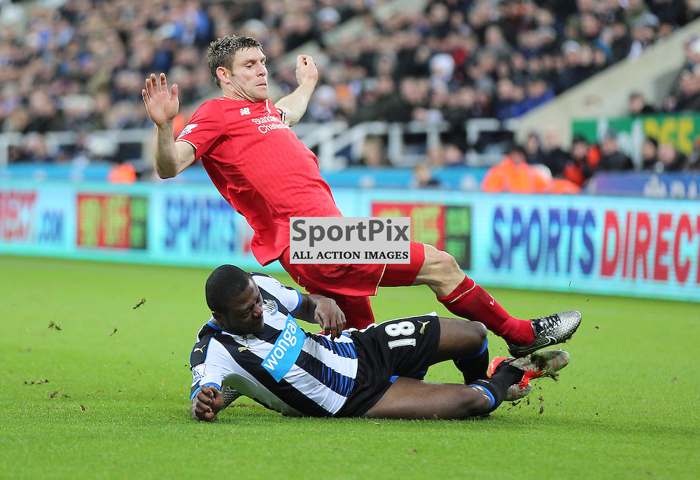 Newcastle United v Liverpool English Premiership 6 December 2015; James Milner (Liverpool, 7) feels the full force of a tackle from Chancel Mbemba (Newcastle, 18) during the Newcastle v Liverpool English Premiership match played at St. James' Park, Newcastle; <br /> <br /> &copy; Chris McCluskie | SportPix.org.uk