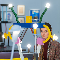 "© Licensed to London News Pictures. 01/11/2016. London, UK. A staff member views ""Ashoka lamp"" by Ettore Sottsass, est. GBP800-1,200. The first look of ""Bowie / Collector"", artworks from the late David Bowie's personal art collection, ahead of their sale later this month at Sotheby's. Photo credit : Stephen Chung/LNP"
