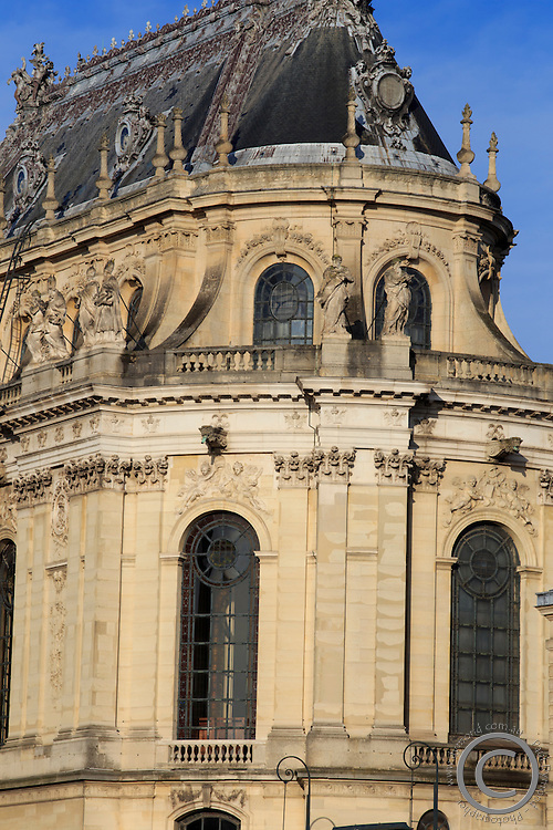 Early morning sun on a frontal facade of Chateau Versaille, on the outskirts of Paris, France.