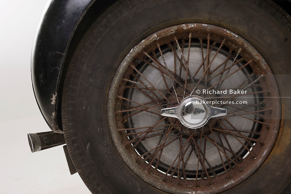 Found in a garage where it had been stored virtually untouched for 50 years, this 1937 Bugatti Type 57s Atalante sports car is previewd for the first time before a Bonhams auction in Paris on February 7th 2009. Original tyes and rusting spokes.