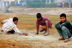 BANGLADESH SIRAJGANJ RADHUNIBARI 30JAN07 - Young Bangladeshi boys play a game of marbles...jre/Photo by Jiri Rezac..© Jiri Rezac 2007..Contact: +44 (0) 7050 110 417.Mobile:  +44 (0) 7801 337 683.Office:  +44 (0) 20 8968 9635..Email:   jiri@jirirezac.com.Web:    www.jirirezac.com..© All images Jiri Rezac 2007 - All rights reserved.