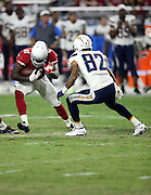Arizona Cardinals rookie safety Harold Jones-Quartey (41) intercepts a third quarter pass while dodging a tackle attempt by San Diego Chargers wide receiver Austin Pettis (82) during the 2015 NFL preseason football game against the San Diego Chargers on Saturday, Aug. 22, 2015 in Glendale, Ariz. The Chargers won the game 22-19. (©Paul Anthony Spinelli)