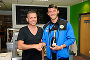 Dale Vince presents the man of the match award to Kieffer Moore at the end of the Vanarama National League match between Forest Green Rovers and Southport at the New Lawn, Forest Green, United Kingdom on 29 August 2016. Photo by Graham Hunt.