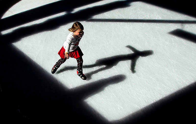 Kara Wixted, 7 from Jonesboro, skates through a patch of sunlight while enjoying opening day of the Arvest on Ice skating rink on Nov 17, 2012 at the Little Rock River Market. The temporary outdoor rink will be open for public skating through January 6, 2013.
