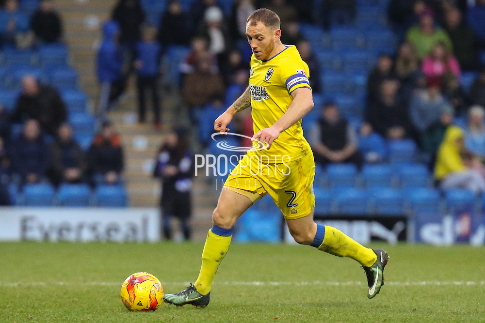 AFC Wimbledon defender Barry Fuller on the ball during the EFL Sky Bet League 1 match between Chesterfield and AFC Wimbledon at the Proact stadium, Chesterfield, England on 21 January 2017. Photo by Aaron  Lupton.
