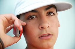 Teenage boy talking on his mobile phone,